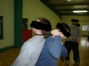 Learning how to choke and garrotte people during Improvised Weapons Training with members of the British Services